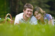 happy young couple having a picnic outdoor