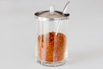 Jar with a red pepper