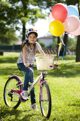Little biker with balloons