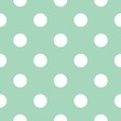 Seamless vector pattern with polka dots on mint green background
