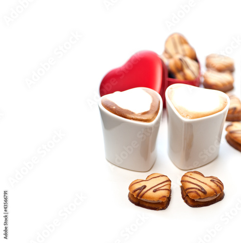 heart shaped cream cookies on red heart metal box and coffee