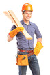 A smiling male carpenter holding sills