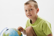 Little boy with globe