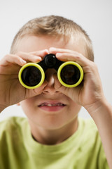 Little boy with binoculars