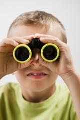 Little boy with binoculars