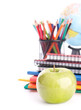Apple, notebook stack and pencils. Schoolchild and student studi