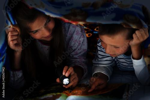 Children reading at night