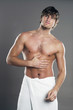 Muscular man wrapped in towel