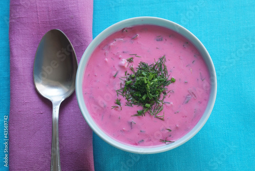 Chłodnik - cold beetroot soup in a bowl on a tablecloth