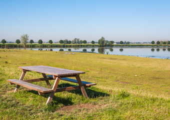 Public wooden picnic table in a nature reserve