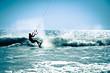 Leinwanddruck Bild - Kite surfing in waves.