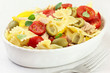 Bow tie pasta salad with tuna, tomatoes and green olives