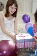 Girl receiving present from her friend