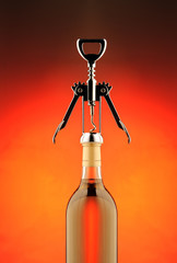 Opening a bottle of white wine with corkscrew