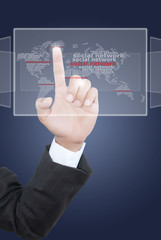 Hand pushing Social Network world map.