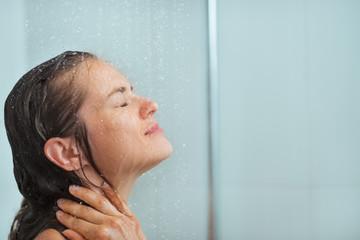 Portrait of woman taking shower