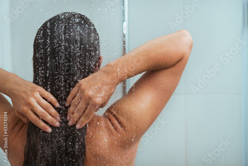 Portrait of relaxed woman taking shower