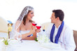 Couple in wedding day cheering with red wine
