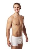 Handsome young man in underwear against white