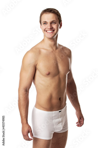 Handsome young man in underwear against white