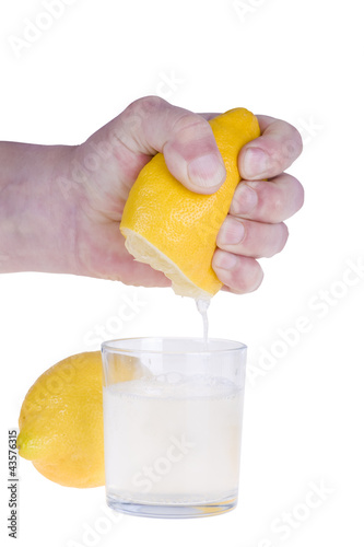 Squeezing lemon on white bacground