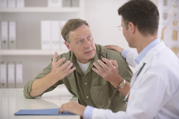 Doctor talking to frightened patient