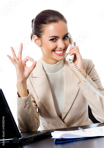 Businesswoman with phone showing thumbs up sign