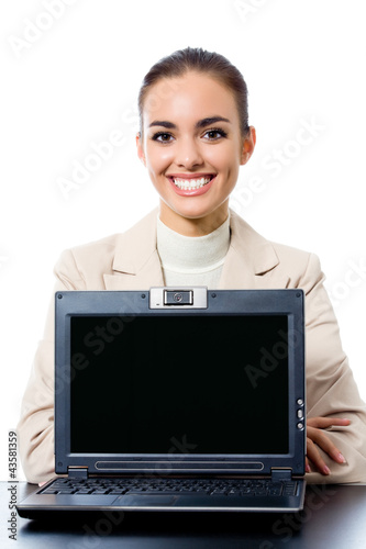 Businesswoman showing laptop with copyspace