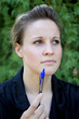 Attractive Young Businesswoman With Pen