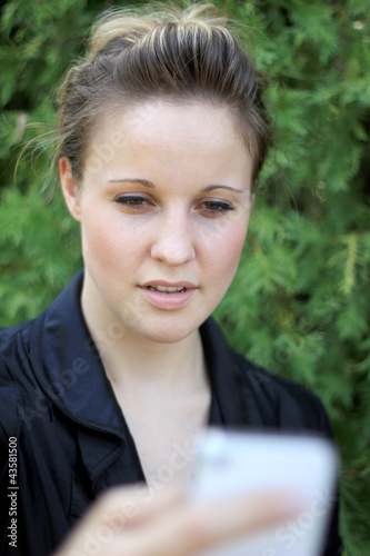 Young Attractive Businesswoman Texting On the Phone