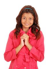 Smiling female child wearing pink coat