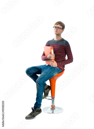 Portrait of a young man sitting on chair