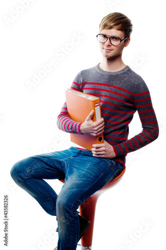 Portrait of a student sitting on chair