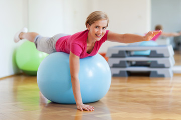 Woman on fitness ball