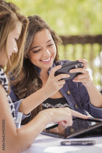 Mixed Race Girls Working on Electronic Devices