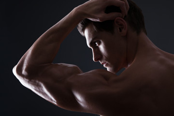 Stylized portrait of muscular man flexing bicep