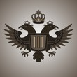 Vintage coat of arms - two-headed eagle with a crown and shield.