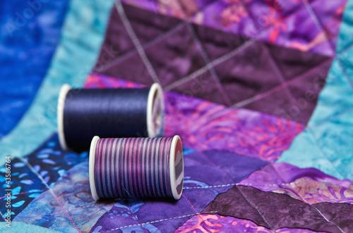 Leinwandbild Motiv Quilt and quilting thread