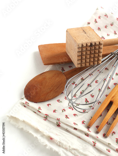 Different kitchen wooden utensils and metal beater