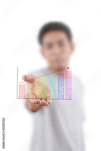 Businessman holding Finance graph.