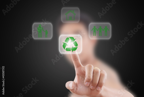 Businessman pushing Recycle Symbol.