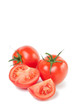 Vertical shot of ripe tomatoes isolated on white