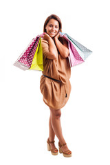 Happy young woman with shopping bags over white