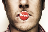 Face Of A Man With Beer Badge