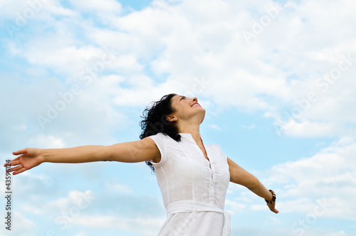 Happy woman with outspread arms