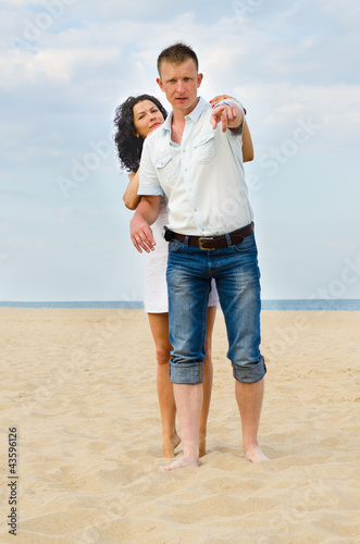 Attractive young couple on a beach