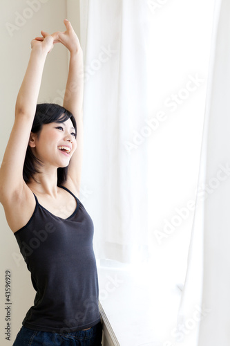 a young asian woman relaxing in morning