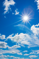 White clouds with sun in the blue sky