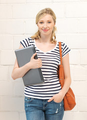 happy and smiling teenage girl with laptop