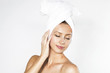 Attractive young blonde woman wearing a towel on her head